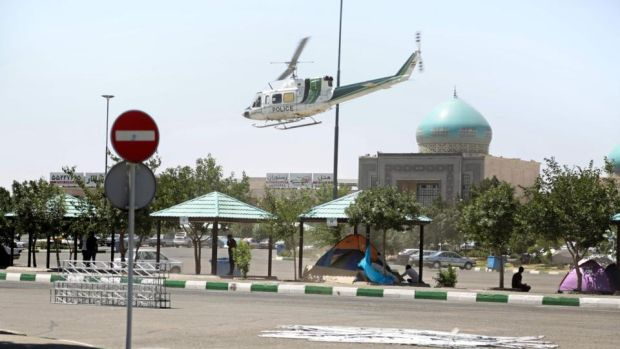 A police helicopter near the mausoleum of Ayatollah Ruhollah Khomeini in Tehran, Iran, after it was attacked on Wednesday. Photograph: Hasan Shirvani/AFP/Getty Images