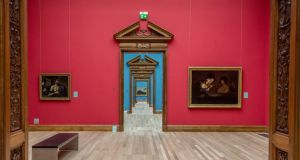 New-look National Gallery of Ireland: stripping back the walls has made the elaborate oak door frames of the Milltown Wing's enfilade – its memorable succession of galleries, almost all now painted blue – even more prominent. Photograph: Brenda Fitzsimons