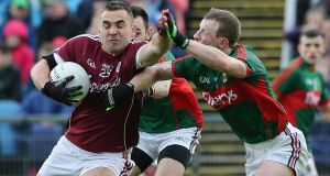 Mayo's Colm Boyle tackles Galway's Patrick Sweeney. Photograph: Lorraine O'Sullivan/Inpho
