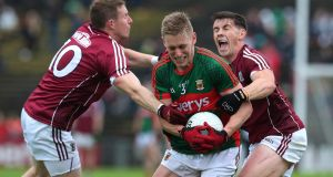 Mayo's Kevin Keane is tackled by Gary Sice and Shane Walsh of Galway during last year's semi-final clash at Castlebar. Photograph: Lorraine O'Sullivan/Inpho