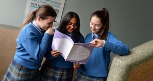 Junior cert students from left; Elizabeth Constantineanu, Sureksha Sukumaran and Aisling Incze  at Mount Carmel Secondary School, King's Inns Street, Dublin.Photograph: Dara Mac Dónaill