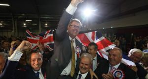 The DUP's Jeffrey Donaldson celebrates following his election at the Eikon Exhibition Centre in Lisburn. Photograph : Brian Lawless/PA