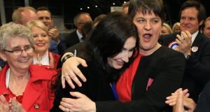 The newest DUP MP Emma Little Pengelly (centre) gets a hug from party leader Arlene Foster after she won the South Belfast seat from the SDLP at the Belfast count centre. Photograph: Paul McErlane