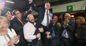 The DUP's David Simpson celebrates at the Eikon Exhibition Centre in Lisburn. Photograph: Brian Lawless/PA