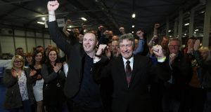 Sinn Féin's   Mickey Brady, right, and Chris Hazzard  celebrate their election.  Photograph:   Brian Lawless/PA Wire