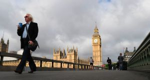 Morning commuters cross Westminster Bridge on Friday with Big Ben and the Houses of Parliament in the background. Photogrpah:  Paul Ellis/AFP/Getty Images