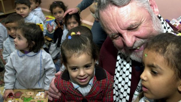 Terry Waite with Palestinian children during a visit to their school at the Beddawi refugee camp in the northern Lebanon in 2004