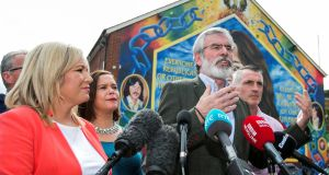 Sinn Fein leader Michelle O'Neill and party president Gerry Adams address journalists in Belfast, Northern Ireland, June 9, 2017. The party will be able to resist presure to take its seats in Westminster  but there will be a growing unease amongst its supporters if the political institutions are not resurrected in the north. REUTERS/Liam McBurney