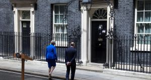 Theresa May and her husband, Philip May, walk back into No 10 Downing Street following her speech on Friday. Photograph: Luke MacGregor/Bloomberg