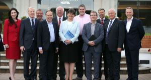 "DUP leader Arlene Foster (centre) with MPs at the Stormont Hotel in Belfast after British prime minister Theresa May  announced that she will work with ""friends and allies"" in the DUP to enable her to lead a government.  Photograph: Brian Lawless/PA"