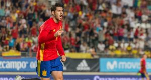 Striker Alvaro Morata celebrates after scoring Spain's  second goal in their friendly match against  Colombia  at the Nueva Condomina stadium in Murcia, Spain. Photograph: Cristobal Osete/EPA