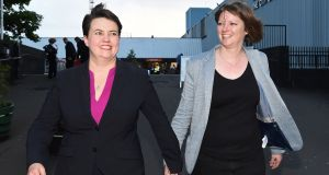 Scottish Conservative leader Ruth Davidson with her partner Jen Wilson after visiting the Meadowbank Sports Centre counting centre in Edinburgh, Scotland, on Friday. Photograph: Lesley Martin/AFP/Getty Images