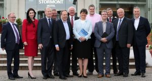 DUP leader Arlene Foster with her members of parliament outside the Stormont Hotel in Belfast.  Photograph: Paul Faith/AFP/Getty Images