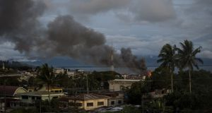 Smoke rises after aerial bombings by Philippine Air Force planes on Islamist militant positions in Marawi, on the southern Philippine island of Mindanao.  Photograph: Noel Celis/AFP/Getty Images