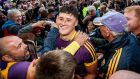 Wexford's Lee Chin is mobbed by supporters after the victory over Kilkenny in the Leinster SHC semi-final at Wexford Park on Saturday night. Photograph: James Crombie/Inpho