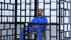 Saif al-Islam Gadafy, son of late Libyan leader Muammar Gadafy, attends a hearing behind bars in a courtroom in Zintan in 2014. Photograph: Reuters
