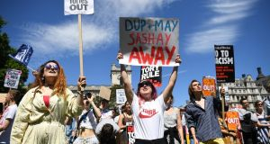 Anti-Conservative Party and anti-DUP demonstrators in Parliament Square in front of the Houses of Parliament in London on Sunday. Photograph: Justin Tallis/AFP/Getty Images
