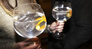 The way gin is served – fishbowl-style glasses with garnishes  – adds to its fashionability. Photograph: Getty Images