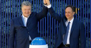 "Ukraine's president Petro Poroshenko and EU ambassador to Ukraine Hugues Mingarelli start a symbolic ""visa-free timer"" at a ceremony marking the launch of a visa-free regime with the EU in Kiev on  Saturday.  Photograph: Sergei Chuzavkov/AP"