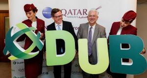 Jonathan Harding, senior vice president of Qatar Airways Europe,  and Dublin Airport managing director Vincent Harrison with  Qatar Airways cabin crew at the launch of the inaugural Dublin to Doha route at Dublin Airport. Photograph: Andres Poveda