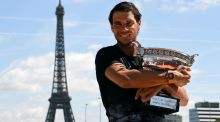 Rafael Nadal poses with the winner's trophy after his tenth victory in the French Open at  Roland Garros. Photograph: Christophe Simon/AFP/Getty