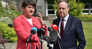 DUP leader Arlene Foster with her  deputy  Nigel Dodds as they hold a press conference at Stormont Castle. Photograph:  Charles McQuillan/Getty Images