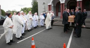 The remains of Concern co-founder Fr Jack Finucane are carried out by  Joe Sweeney and Jack Finnucane jnr and others at the Church of the Holy Spirit, Kimmage Manor, Dublin. Photograph: Gareth Chaney Collins