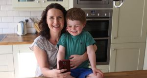 Andrea Mara with her son Matthew, and her smartphone