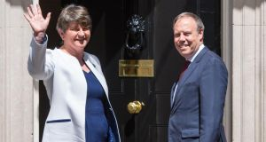 DUP leader Arlene Foster and  deputy leader Nigel Dodds arriving at 10 Downing Street in London for talks on a deal to prop up a Tory minority administration. Photograph:  Dominic Lipinski/PA Wire