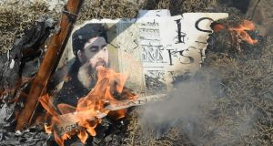 Indian Shia Muslim demonstrators burn an effigy of Islamic State group leader Abu Bakr al-Baghdadi during a protest in New Delhi. Photograph: Getty Images