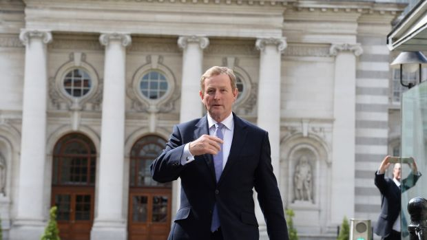 Taoiseach Enda Kenny leaving Government buildings to go to Áras an Uachtaráin to submit his resignation to President Michael D Higgins. Photograph: Cyril Byrne