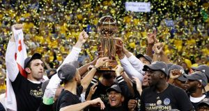 Golden State Warriors celebrate with the Larry O'Brien NBA Championship Trophy. Photograph: PA