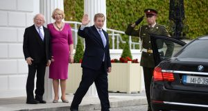 Enda Kenny  leaving Áras an Uachtaráin after delivering his letter of resignation as Taoiseach to President Michael D Higgins, seen with his wife Sabina. Photograph: Dara Mac Dónaill