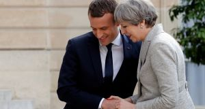 "French president Emmanuel Macron  and British prime minister Theresa May:  aim ""to strengthen the commitments and obligations of internet operators to delete any content promoting hatred and terrorism"".  Photograph: Philippe Wojazer/Reuters"