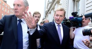 Taoiseach Enda Kenny waving to well wishers as he left Government Buildings to go to Áras an Uachtaráin to resign. Photograph: Cyril Byrne