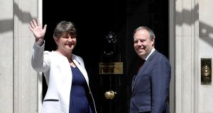 Leader of the DUP Arlene Foster and Deputy Leader Nigel Dodds stand on the steps of 10 Downing Street before talks with Britain's Prime Minister Theresa May. Photograph: Phil Noble/Reuters