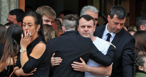 Family and friends console each other after the funeral Mass  of Michael Keogh this morning at St Francis Xavier Church, Gardiner Street, Dublin. Photograph: Colin Keegan/Collins Dublin