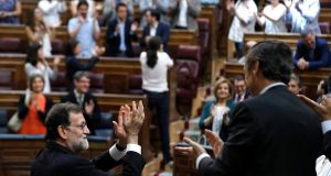 Spanish prime minister Mariano Rajoy receives a standing ovation from his party colleagues at the end of a  no-confidence motion in parliament on Wednesday. Photograph: Emilio Naranjo/EPA