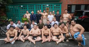 Ireland players and management pose for a photo with sumo wrestlers at Shikoroyama-beya in Koto-ward in Tokyo. Photograph: Ryan Byrne/Inpho