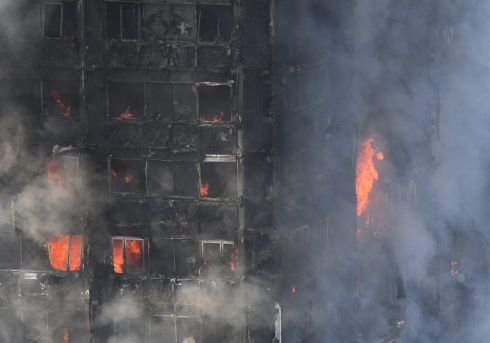 A view of flames and smoke from the fire at the Grenfell Tower apartment block in North Kensington, London.  Photograph: EPA