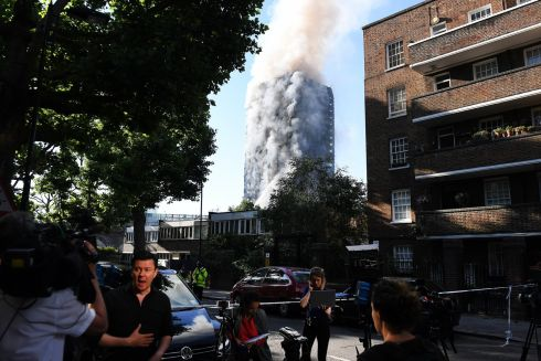 Media gather outside the huge tower block fire in west London. Photograph: EPA/Andy Rain