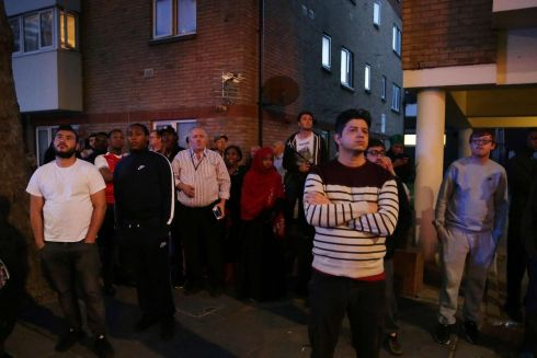 Local residents watch as Grenfell Tower is engulfed by fire. Photograph:  AFP/Getty Images