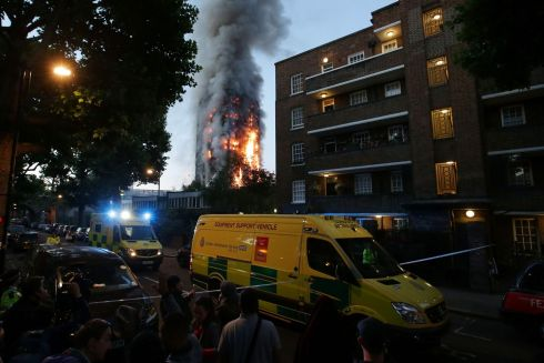 A security cordon holds people backs as Grenfell Tower is engulfed by fire. Photograph: Getty