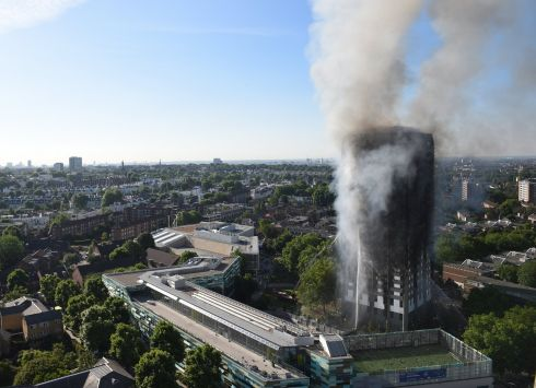 Smoke rises from the fire at the Grenfell Tower apartment block. Photograph: getty