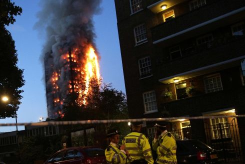 Police man a security cordon as a huge fire engulfs the Grenfell Tower. Photograph: Getty