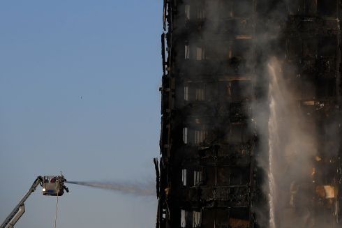 Firefighters tackle a serious fire in a tower block at Latimer Road in West London. Photograph: Reuters/Toby Melville