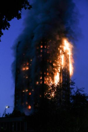 A huge fire engulfs the Grenfell Tower. Photograph: Getty