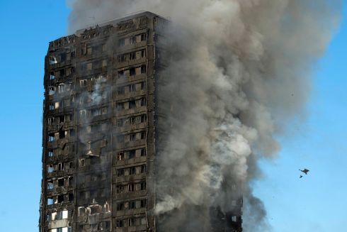 Smoke rises from the fire at the Grenfell Tower apartment block.  Photograph: Will Oliver / EPA