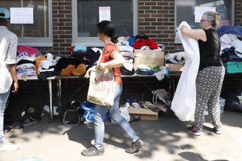 Clothes are offered to those affected by the fire.  Photograph:  Adrian Dennis / AFP