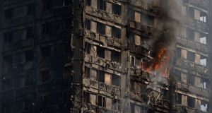 "The burnt-out Grenfell Tower: Rainscreen cladding on the  tower was, according to Rydon Construction, put there with the aim of ""improving thermal insulation and modernising the exterior of the building"". The company finished refurbishing the building last summer.  Photograph: Chris J Ratcliffe/Getty Images"